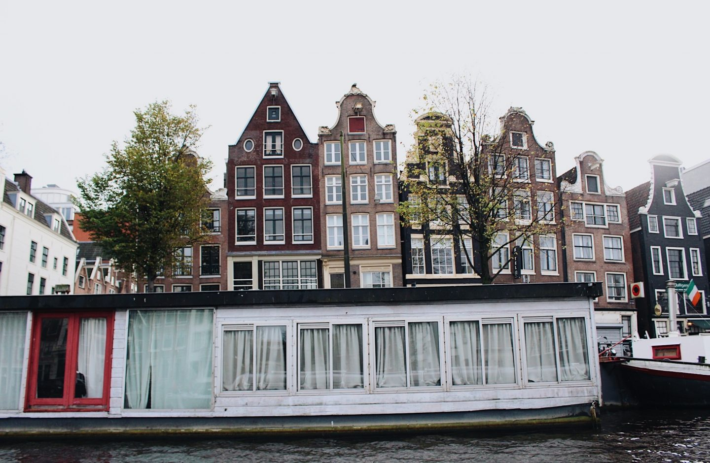 Looking at house boats on an Amsterdam canal tour!