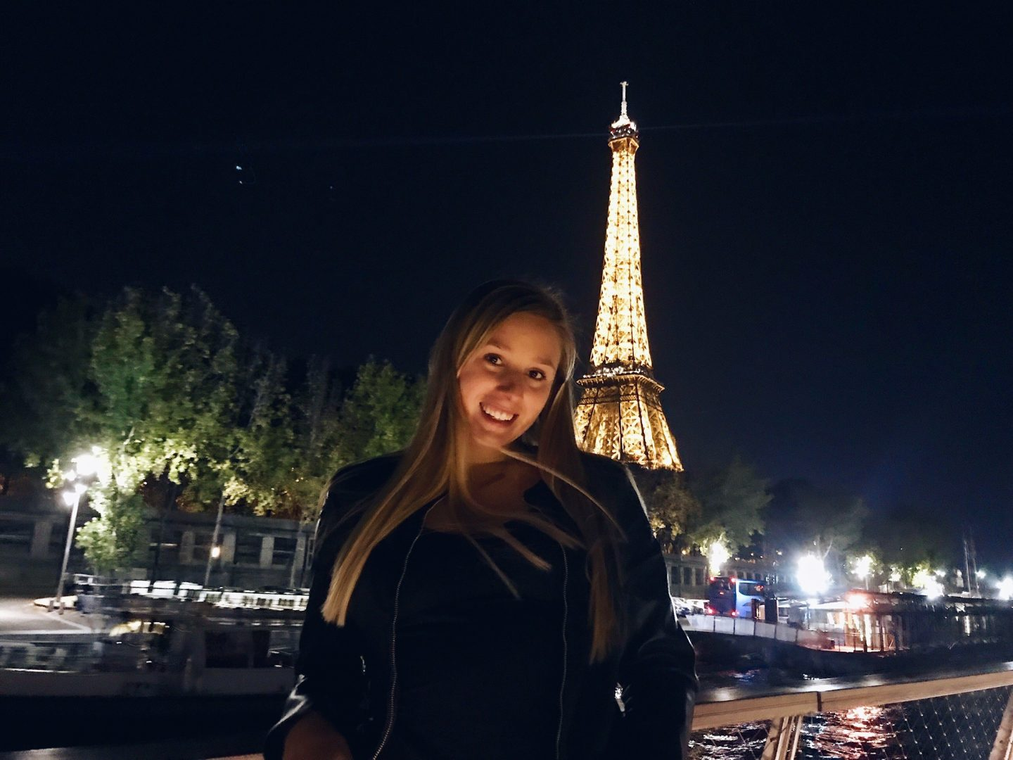 A view of the Eiffel Tower at night on a Seine River cruise