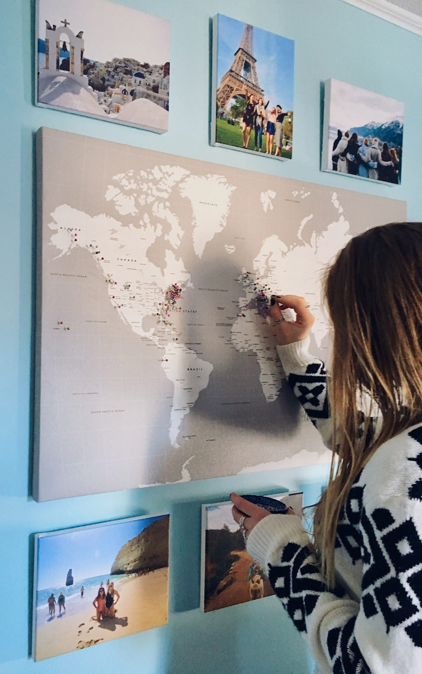 Putting pins in the world map hanging in my room!