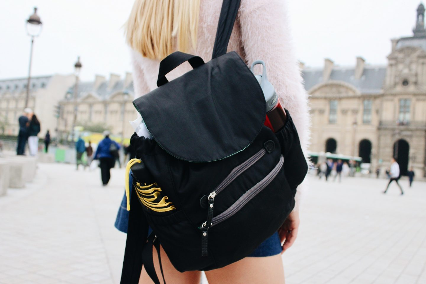 Posing with my travel backpack in Paris, France!