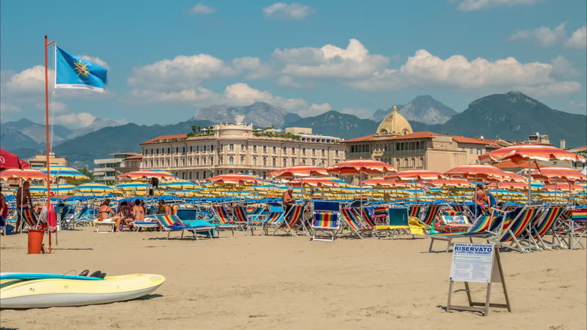 The beach and Italian alps in Viareggio, Italy.
