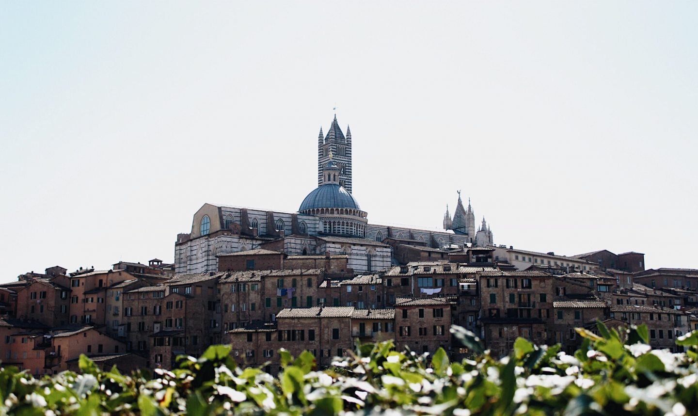 Photo of Siena, Italy on the hillside.