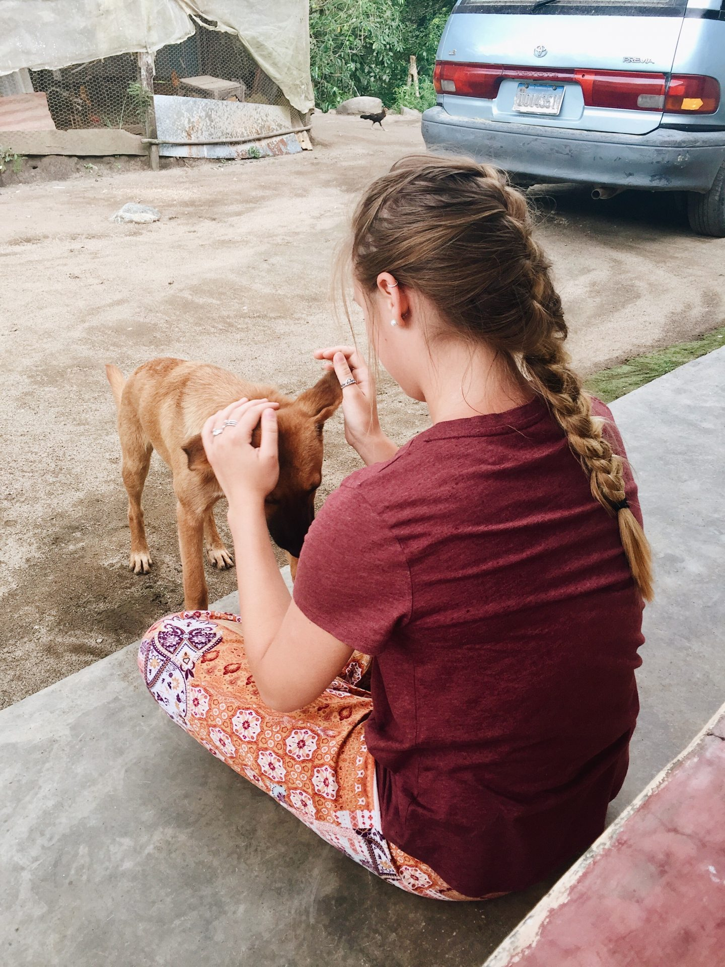 Playing with one of the local puppies in the Dominican Republic