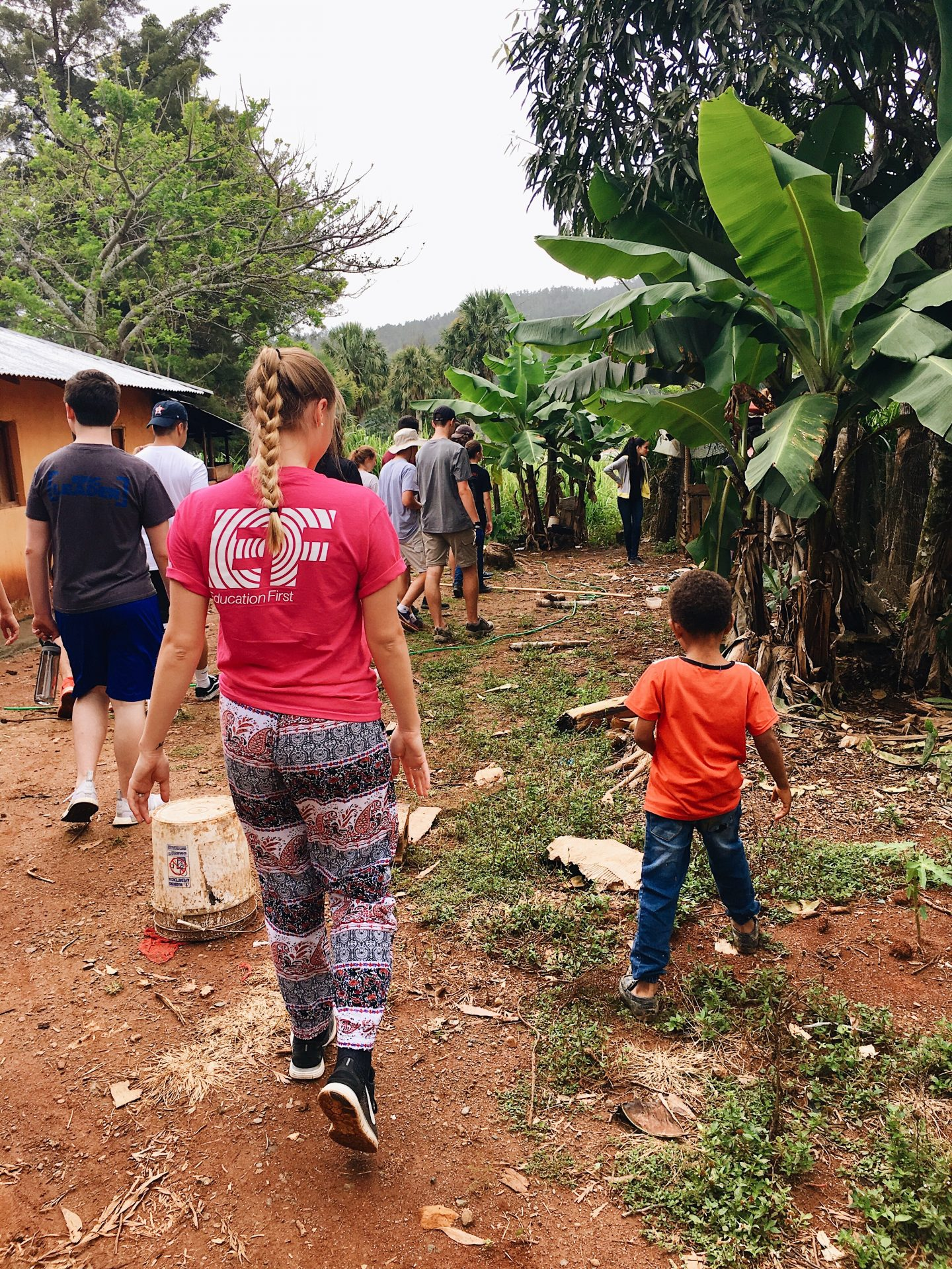 Walking through a volunteer site in the DR with EF students!