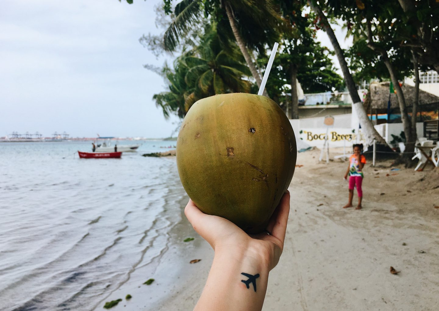 Drinking from a fresh coconut in Boca Chica, Dominican Republic!