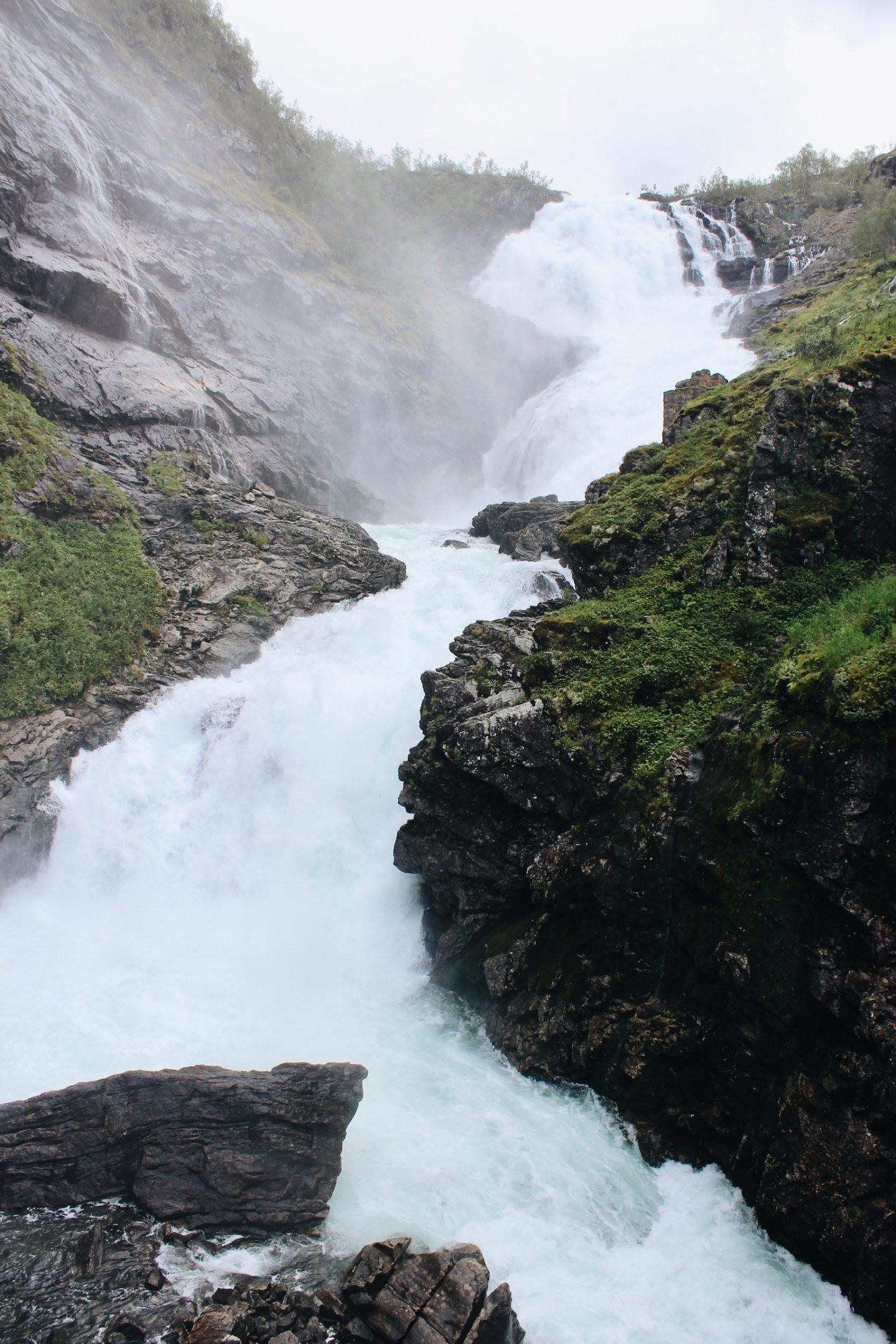 Passing a waterfall on the Flam Railway from Oslo to Bergen in Norway!