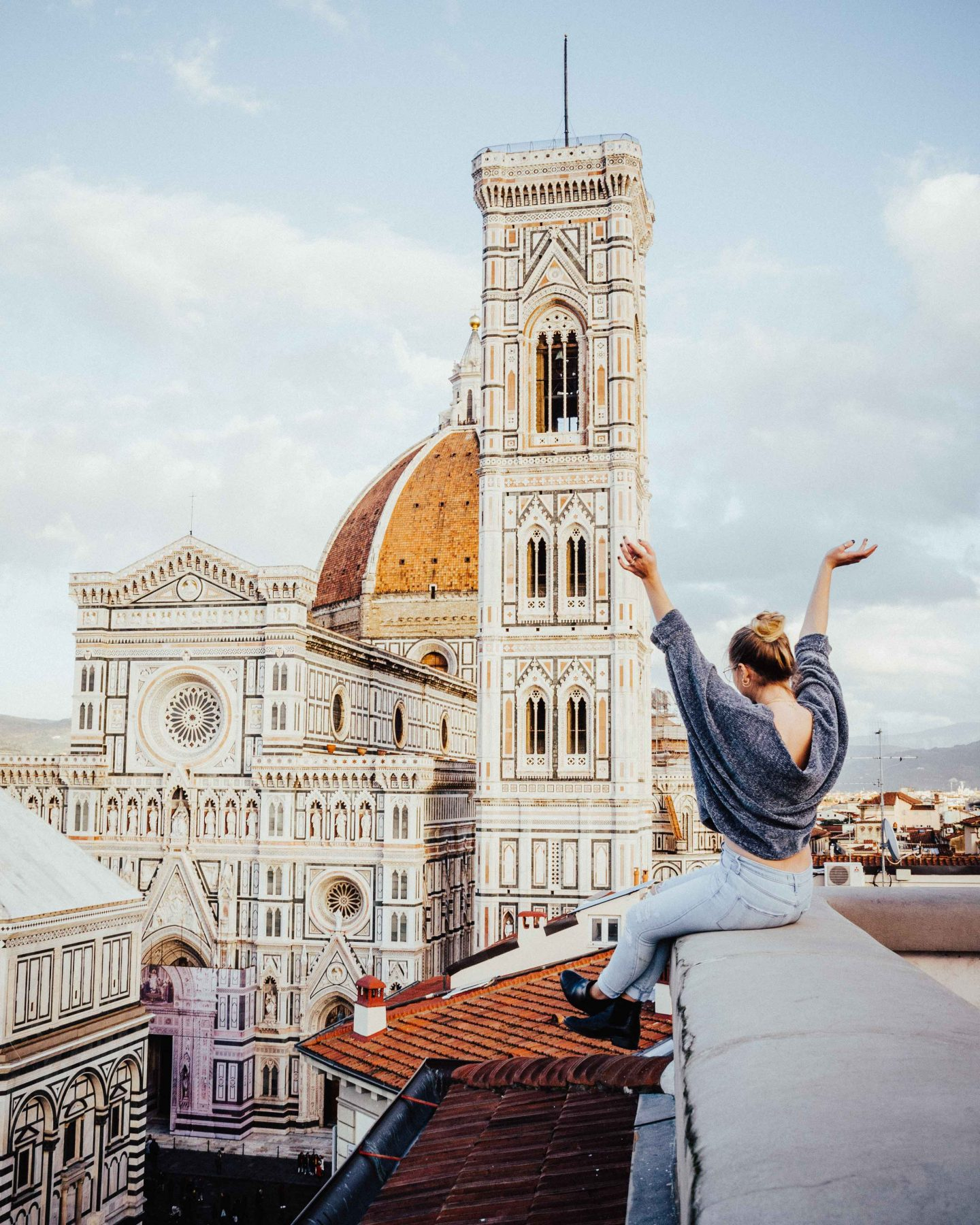 Posing on an apartment rooftop overlooking the Duomo in Florence, Italy!
