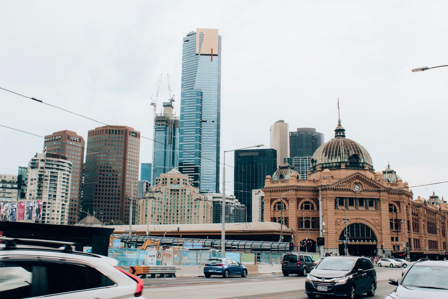 Flinders Street Station and the downtown Melbourne skyline.