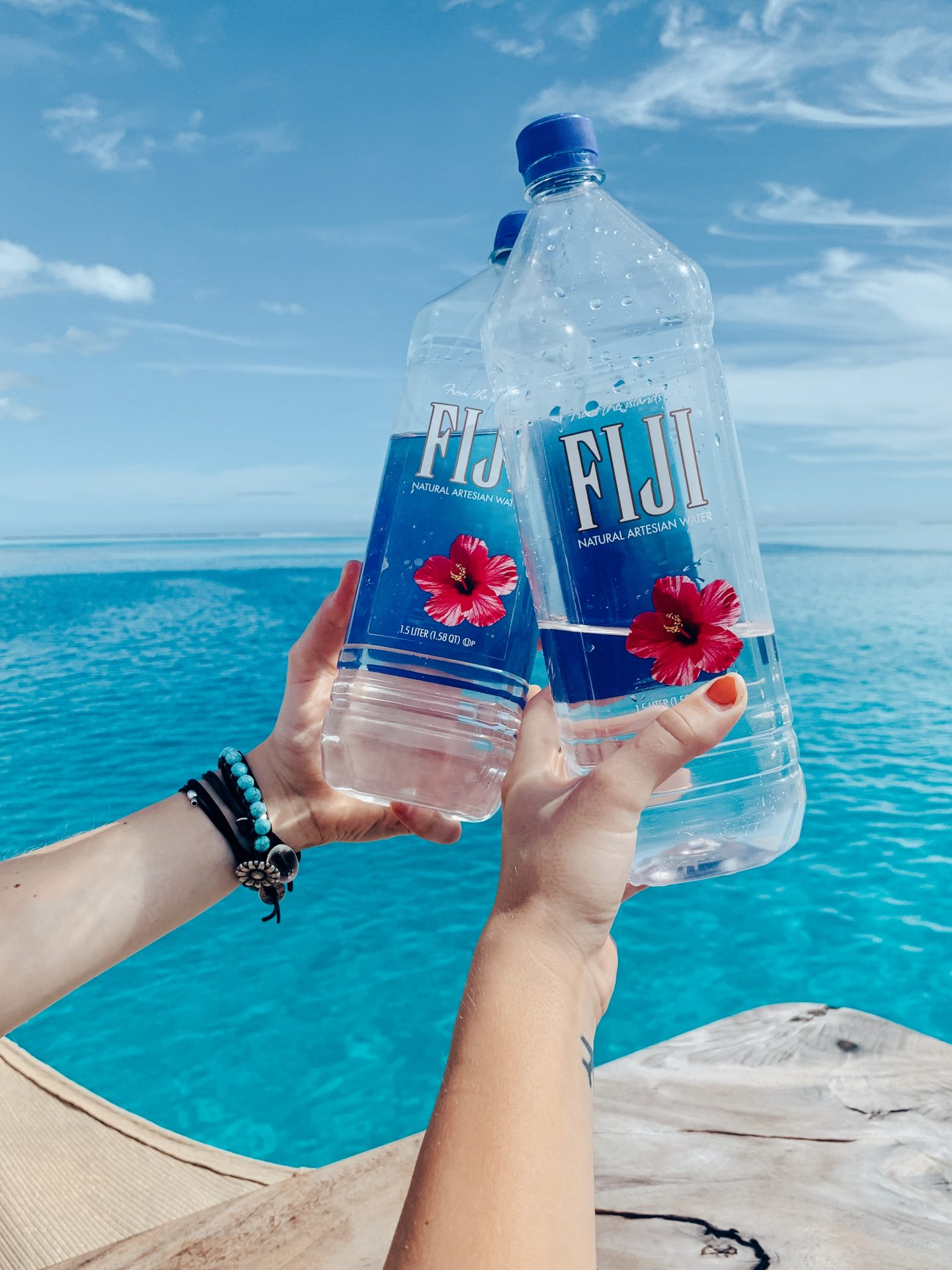 Drinking Fiji water overlooking the crystal clear blue waters of Fiji!