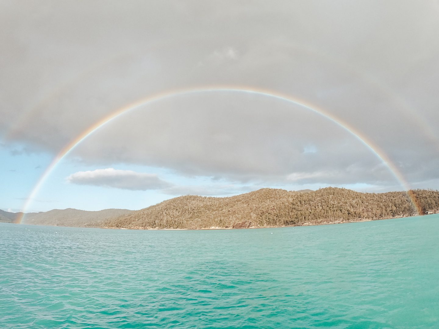 Morning rainbow over the Whitsunday Islands in Queensland, Australia!