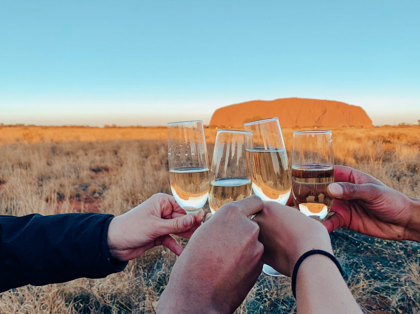 Drinking champagne at sunset in the Outback.