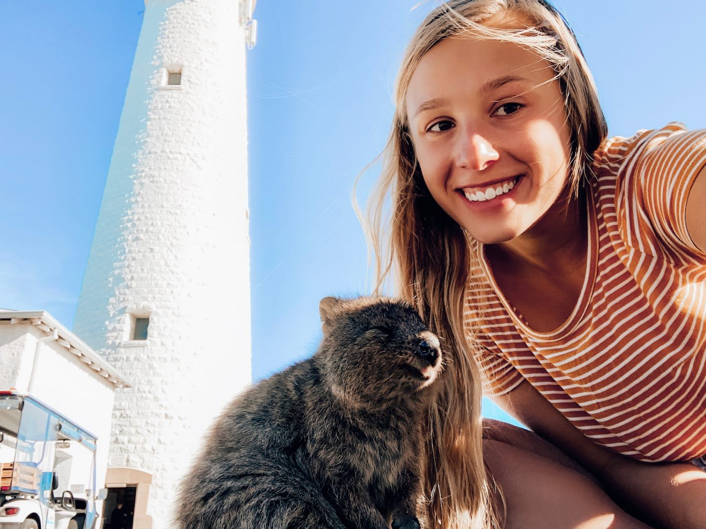 Posing with a quokka for a selfie on Rottnest Island!