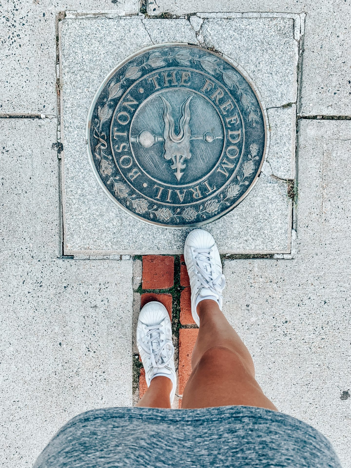 Standing at the start of the Freedom Trail in Boston, MA